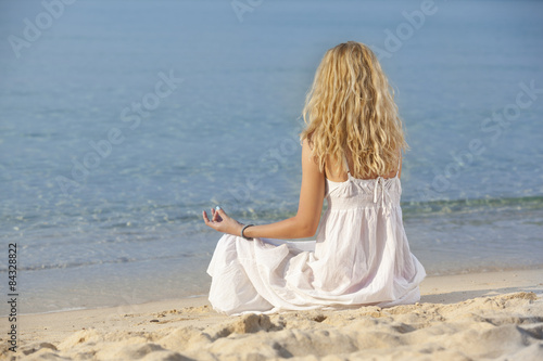 Deurstickers Ontspanning woman meditating and relaxing on beach