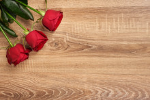Red Rose Flower On Wood