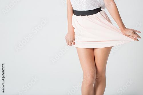 Fotomural Piernas de la mujer en una falda