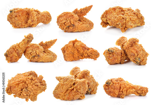 Golden brown fried chicken on white background.