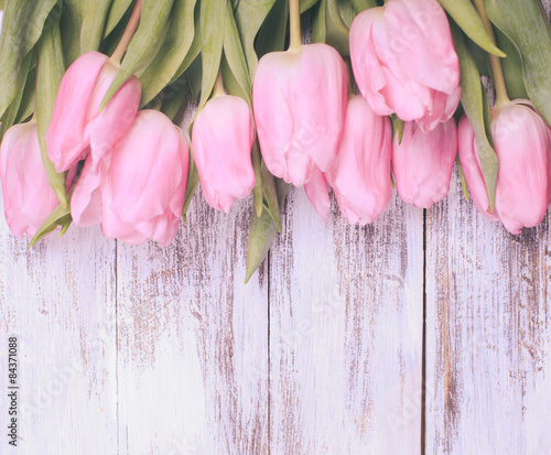 Fototapeta Pink tulips over wooden table obraz na płótnie