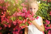 Portrait Of Pretty Little Girl Face In Pink Flowers Tree