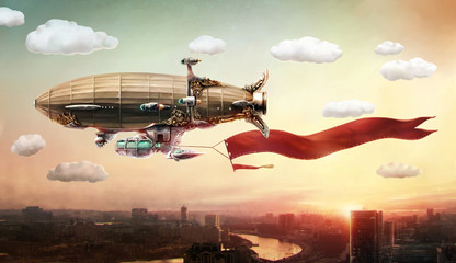 FototapetaDirigible with a banner, in the sky over a city.