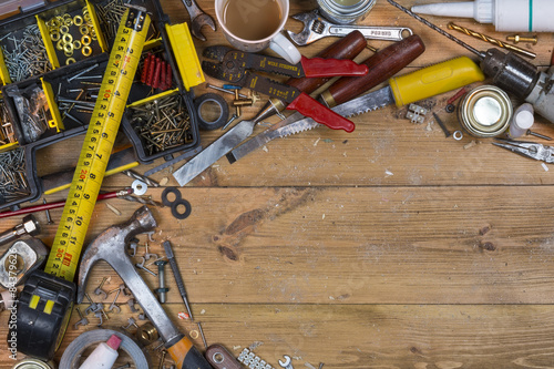 Fotografie, Obraz  Untidy Workbench - Old Tools - Space for Text
