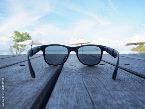 Black sunglasses on the beach.