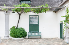 Grape Vine, Bench And Window With Barn Doors