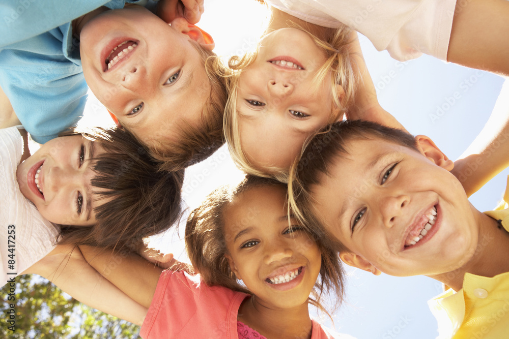 Fototapety, obrazy: Group Of Children Looking Down Into Camera
