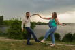 Pregnancy, family, expectation of the child. Young couple on the lake shore