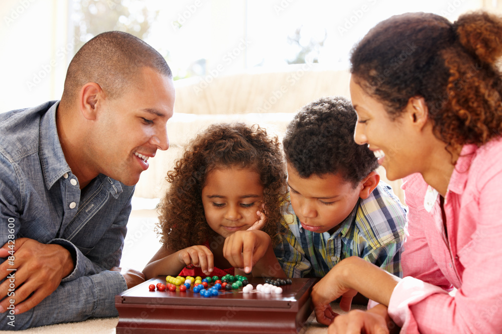 Fototapety, obrazy: Mixed race family playing solitaire