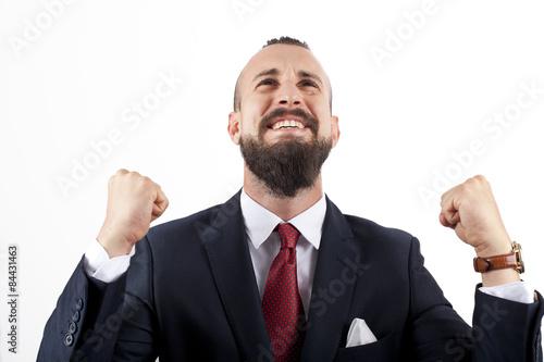 Fotografía  Hombre de negocios con traje y pañuelo con gesto triunfal