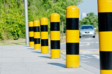 Yellow And Black Road Safety Studs With Selected Focus In A Sunny Day