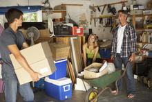 Teenage Family Clearing Garage...