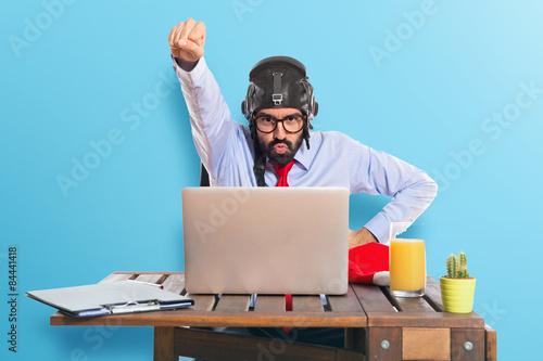 Slika na platnu Businessman in his office with pilot hat