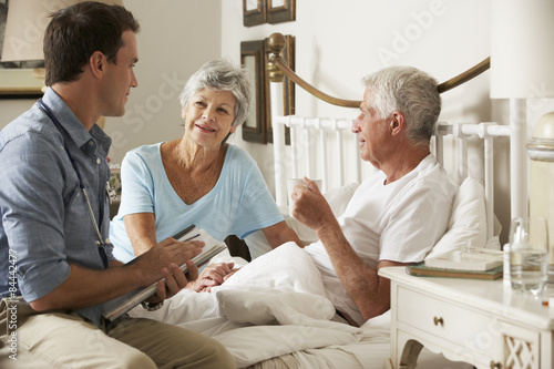 Fotografie, Obraz  Doctor On Home Visit Discussing Health Of Senior Male Patient With Wife