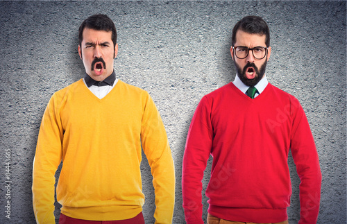Photo  Twin brothers with moustache shouting