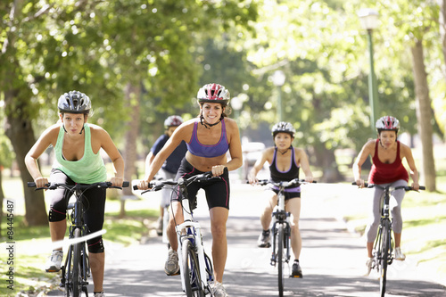 Group Of Women On Cycle Ride Through Park