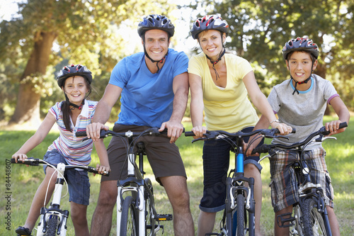 Family On Cycle Ride In Countryside Poster