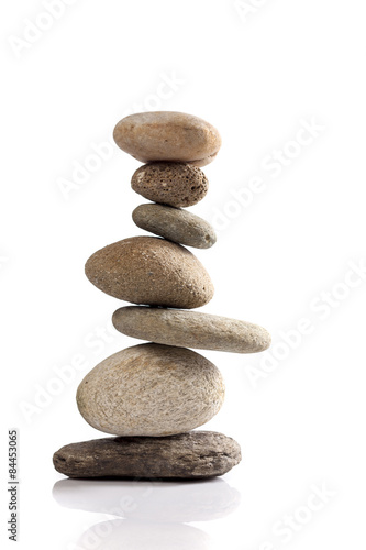 Photo  Balanced stack of different river stones