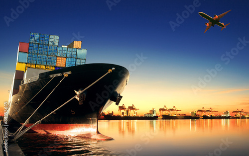Valokuvatapetti container ship in import,export port against beautiful morning l