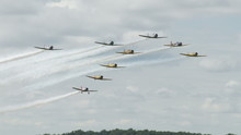 USAF T-6 Texans Flying In A T-formation With Canadian Air Force Harvards, Small Training Aircraft From WWII.