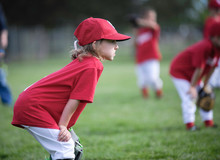 Focused Child Ready To Play Ball