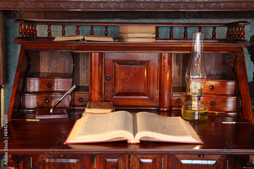 Antique desk with books and and magnifying glass - Antique Desk With Books And And Magnifying Glass - Buy This Stock