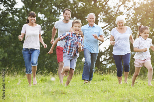 Fotografia  Multi Generation Family Running Across Field Together
