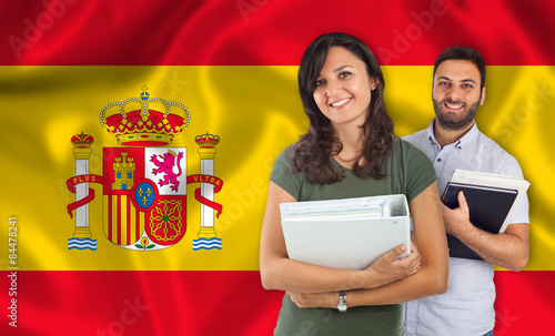Couple of students over spanish flag