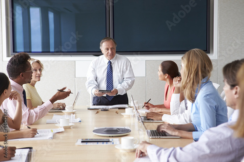 Fototapety, obrazy: Group Of Businesspeople Meeting Around Boardroom Table