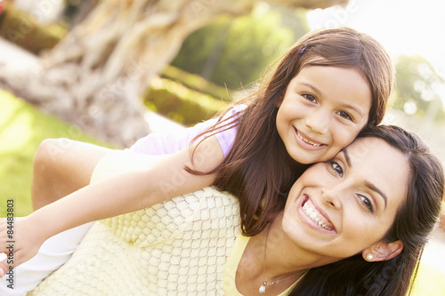 Fotografie, Obraz  Portrait Of Hispanic Mother And Daughter In Park