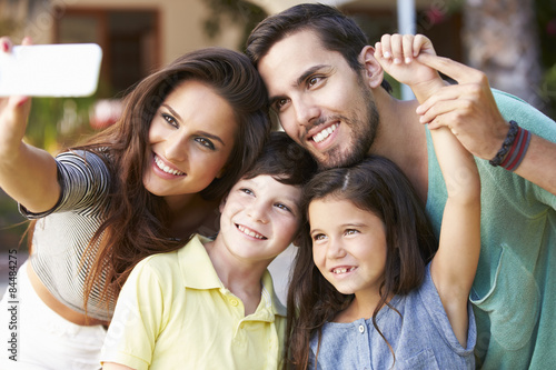 Family In Garden Taking Selfie On Mobile Phone Canvas Print