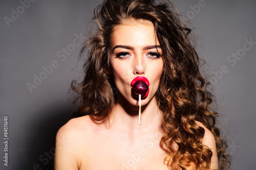 Obraz na plátne Delightsome woman with lollipop