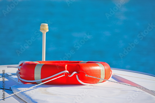Fotografie, Obraz  life saver ring on a boat rooftop