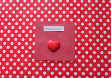 Hugging Makes Happy Days Happier - Message Next To A Red Love Heart