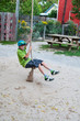 boy playing on a rope swing