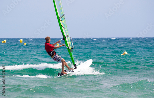 fototapeta na lodówkę Nastolatka surft