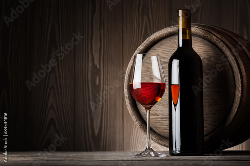 Red wine in glass with bottle