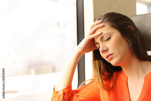 Photo  Passenger feeling dizzy in a train travel
