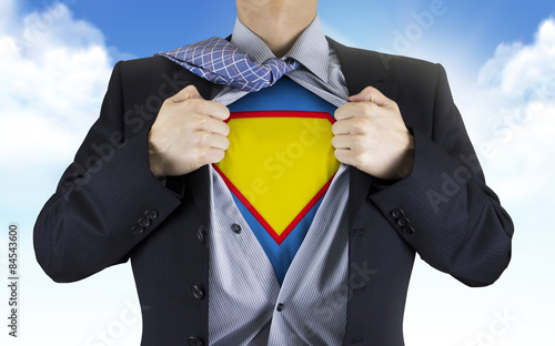businessman showing superhero icon underneath his shirt Fototapet