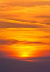 Naklejka Na szklane drzwi i okna Bright sunset in cirrus fiery clouds - vertical nature backgroun