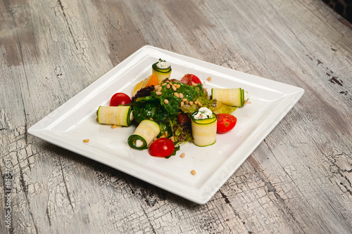 Aluminium Prints Assortment Salad with cherry tomatoes, cucumbers and meat on white plate