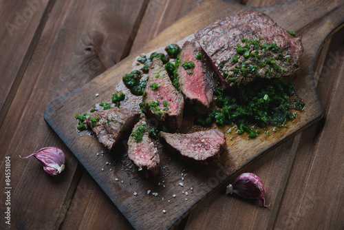 Medium rare grilled beef barbecue steak with chimichurri sauce Tablou Canvas