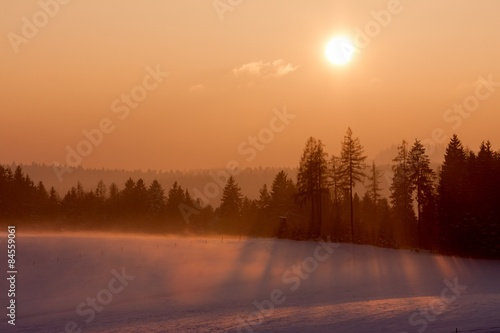 Sunset in winter landscape.