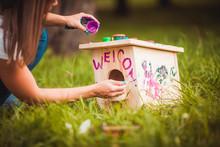 Girl Painting Birdhouse