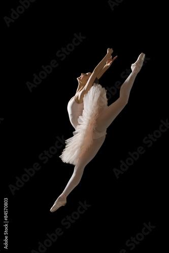 Leinwand Poster Ballerina in jump isolated on black