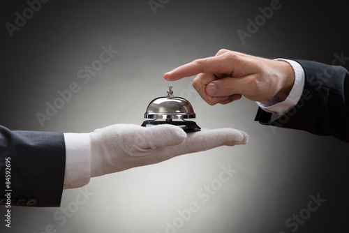 Fotografering Close-up Of A Person's Hand Ringing Service Bell