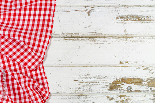 Tuinposter Stof Red folded tablecloth over wooden table