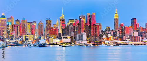 Panoramic view of Manhattan skyline with red sunlight reflection. #84613691