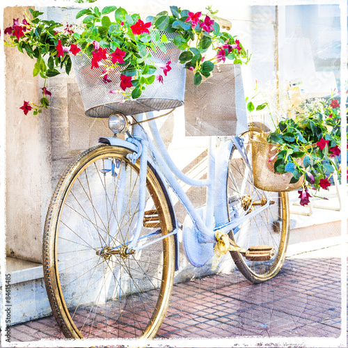 Staande foto Fiets charming street decoration with bike and flowers, artistic pictu