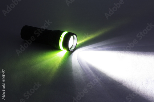 Obraz Black Flashlight, Beam from flashlight on a paper - fototapety do salonu